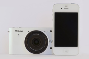 http:  taishimizu.com pictures nikon j1 review nikon j1 and white iPhone 4s front thumb.jpg